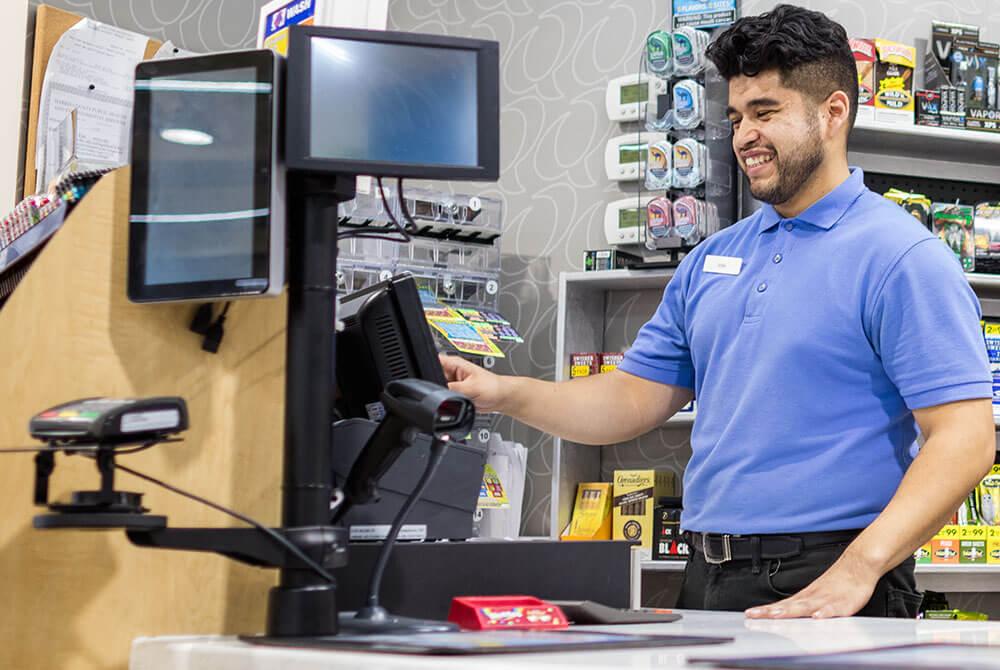 Smiling cashier at 76 gas station