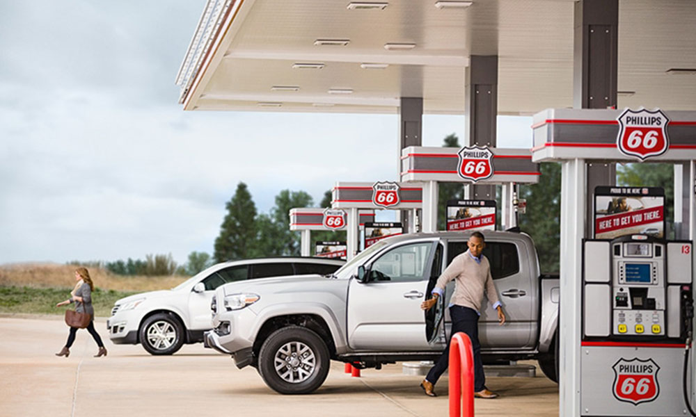 Multiple customers at a Phillips 66 gas station